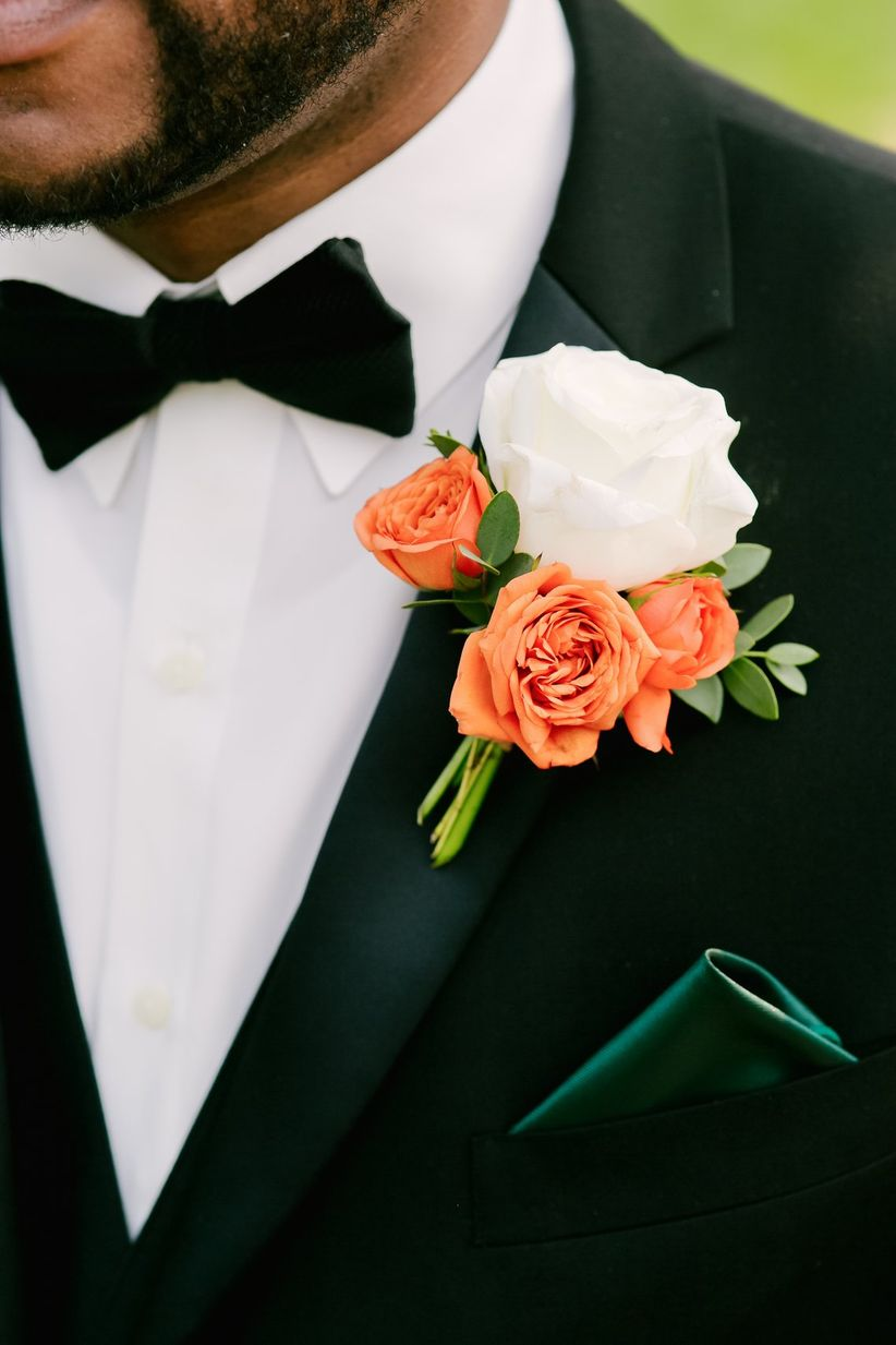 autumnal groom black tux silk lapels emerald green pocket square white and orange rose boutonniere