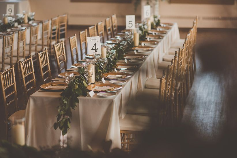 long banquet table with greenery runner