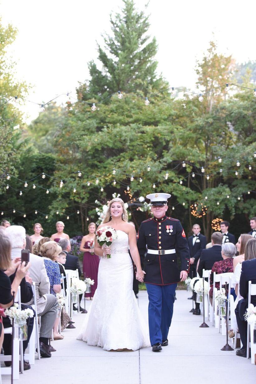 bride and groom recessional at garden venue
