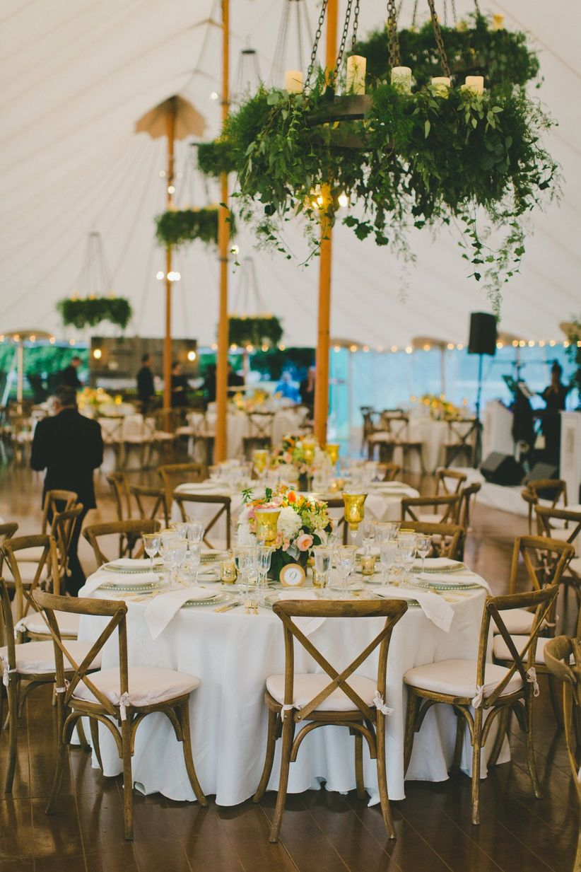 sailcloth tent with greenery chandeliers