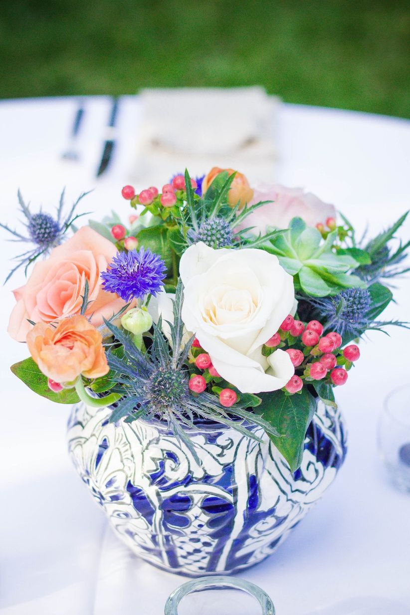 coral and blue centerpiece with ginger jar