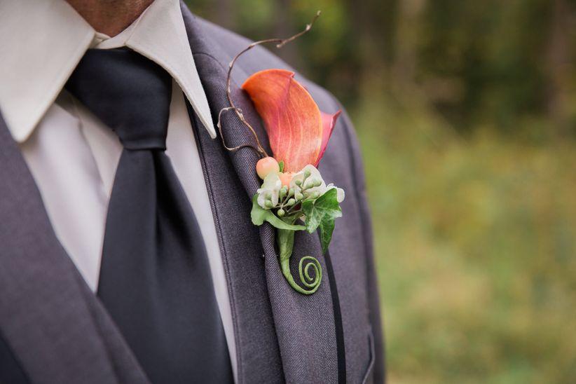 formal groom's attire gray tux black piping dark necktie bright calla lily and fiddlehead fern boutonniere