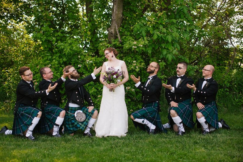 groomsmen in kilts kneeling with bride - abbey grim photography