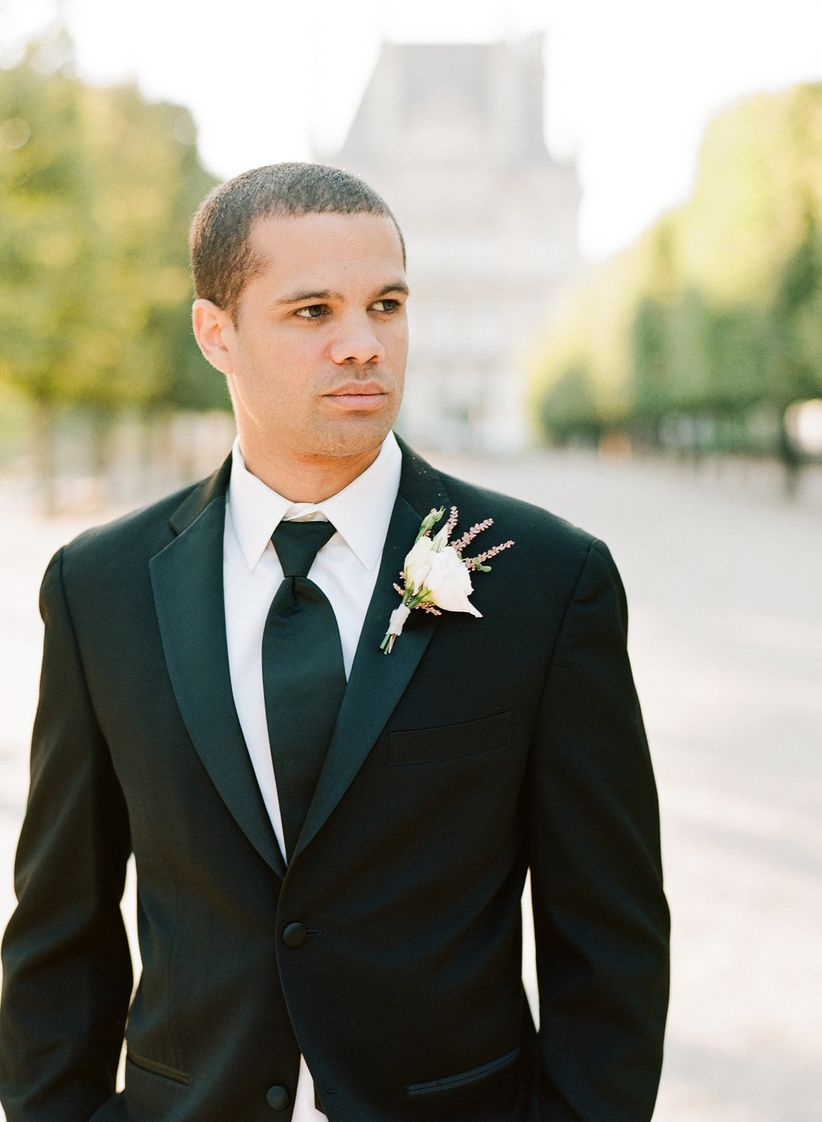 groom wearing a traditional black tuxedo for formal wedding
