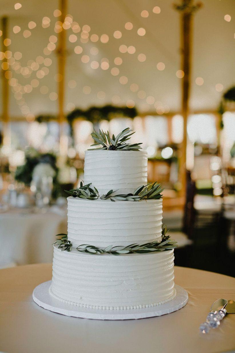 buttercream cake with fresh greenery