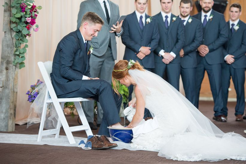 bride and groom foot washing ritual <li>brett loves elle photography