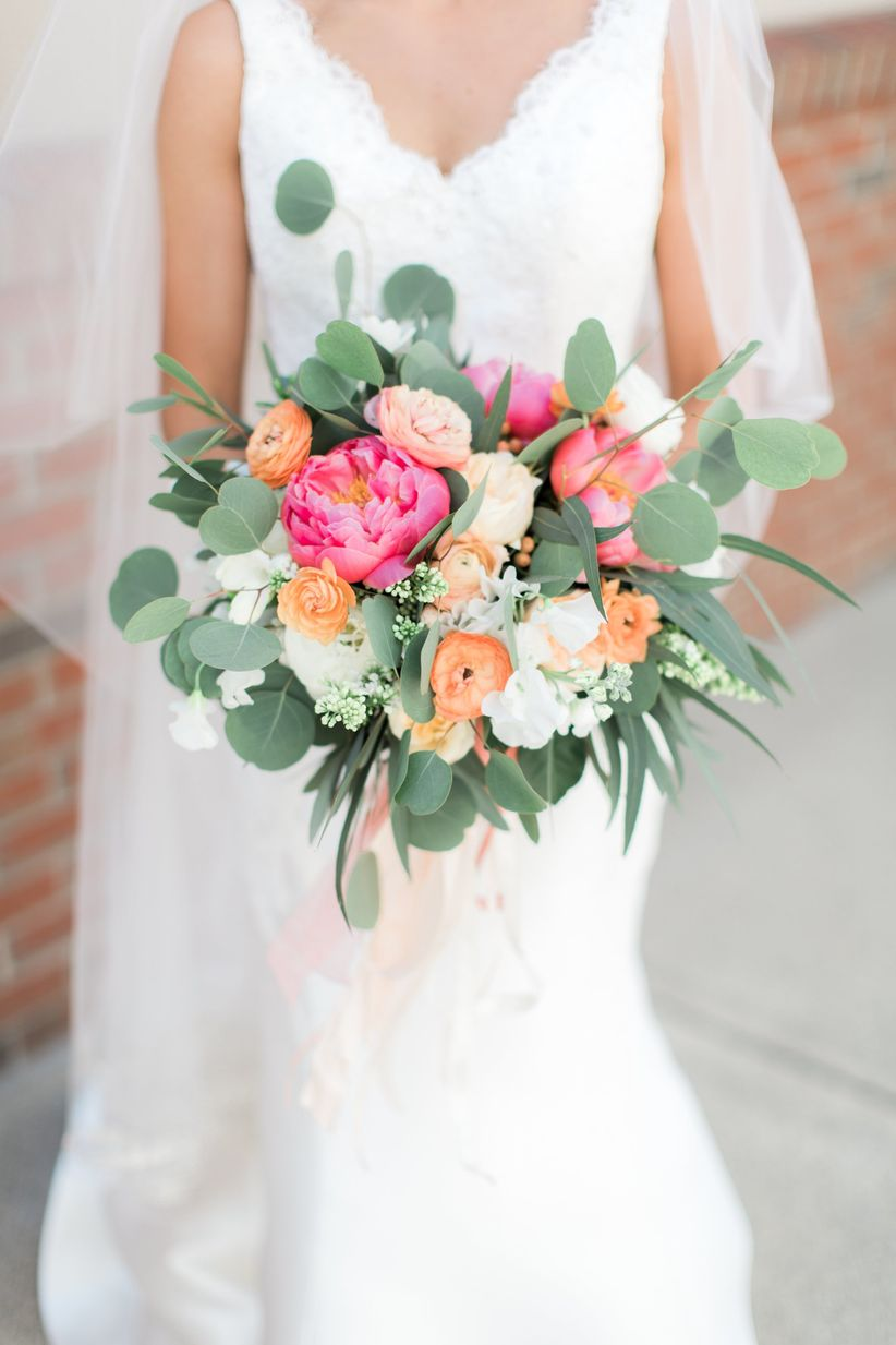 coral peony bouquet with greenery