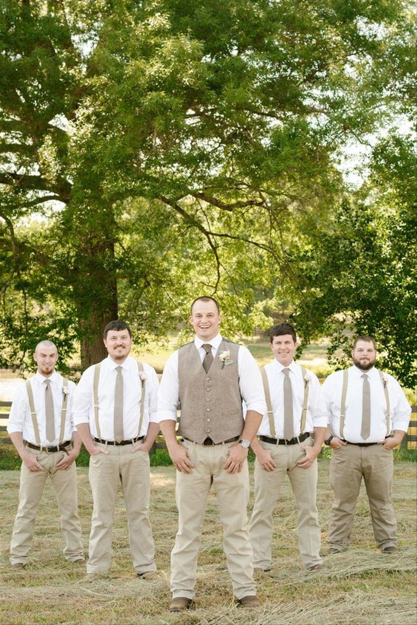 groom and groomsmen outdoor country rustic groomsmen khakis suspenders brown necktie groom in brown vest boutonnieres