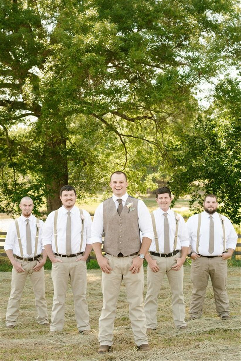 fa79e0f65dcdb groom and groomsmen outdoor country rustic groomsmen khakis suspenders  brown necktie groom in brown vest boutonnieres