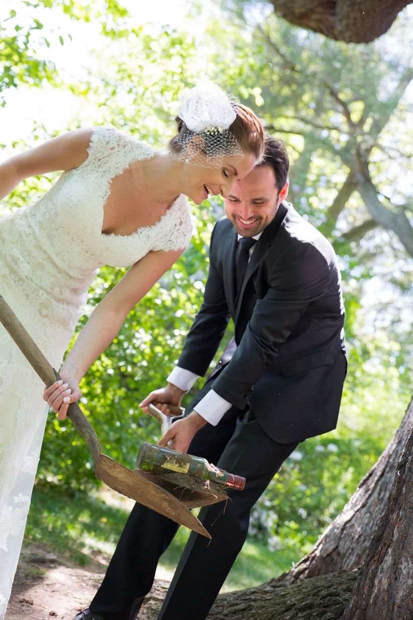 bride and groom burying the bourbon <li>little blue lemon photography & cinematography