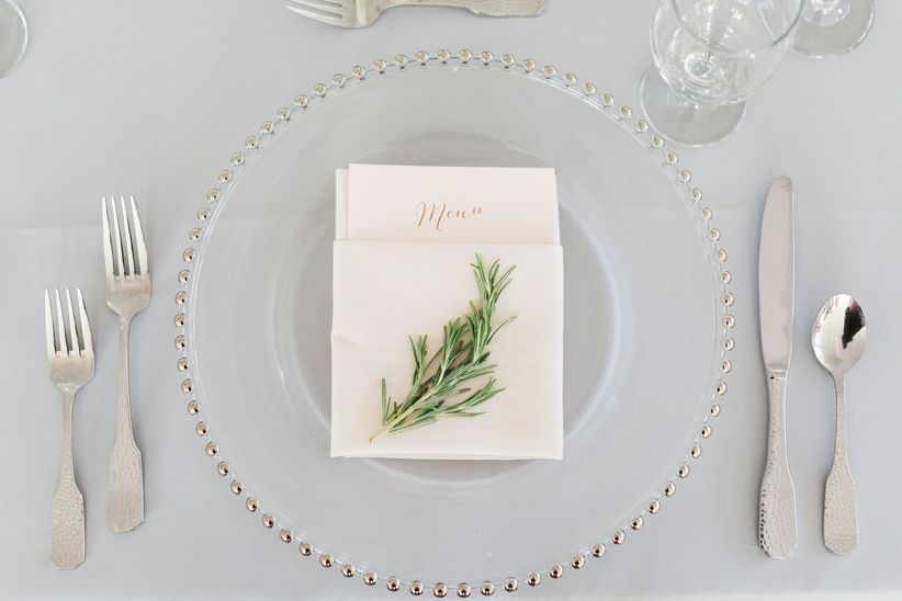 place setting decorated with fresh rosemary