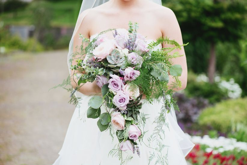 cascading purple rose bouquet