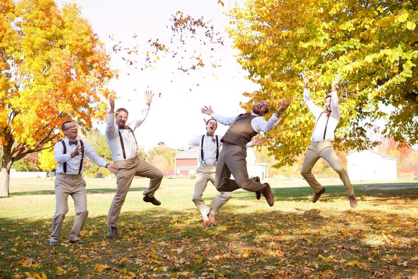 groomsmen jumping with fall leaves - sweetcheeks photography
