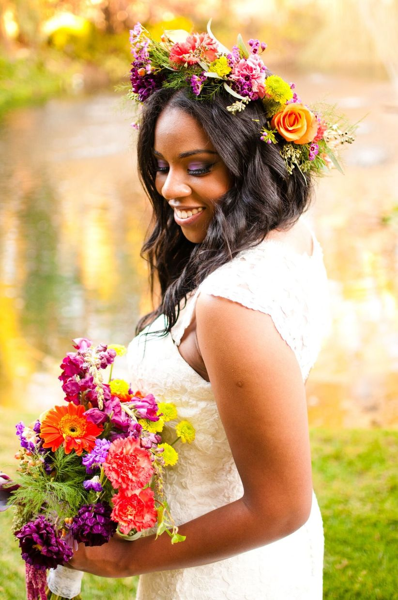 Our 16 favorite wedding hairstyles with flowers weddingwire colorful bridal flower crown izmirmasajfo