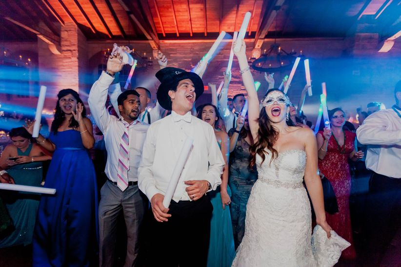 Couple and guests dancing during reception