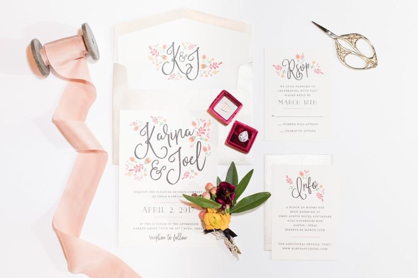 romantic wedding invitations decorated with flowers and blush and burgundy colors