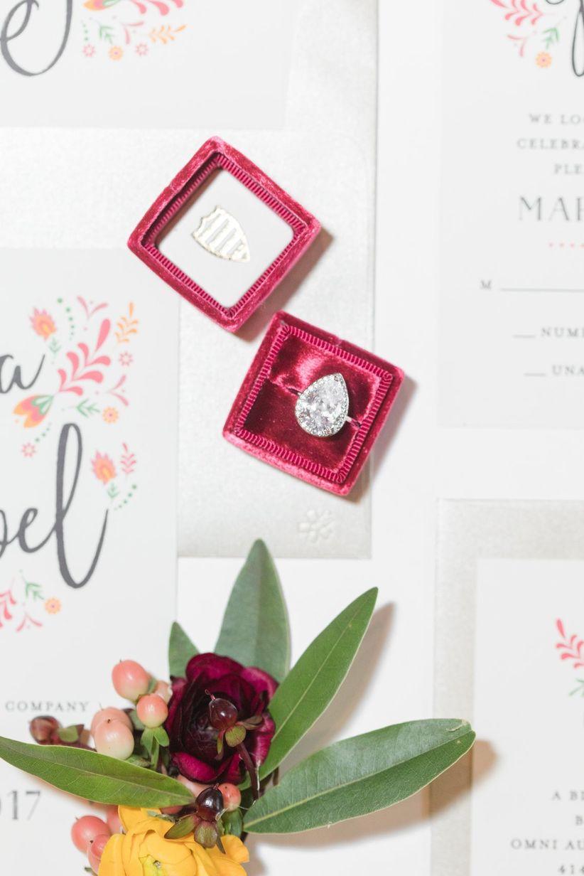 pear cut engagement ring in burgundy velvet ring box