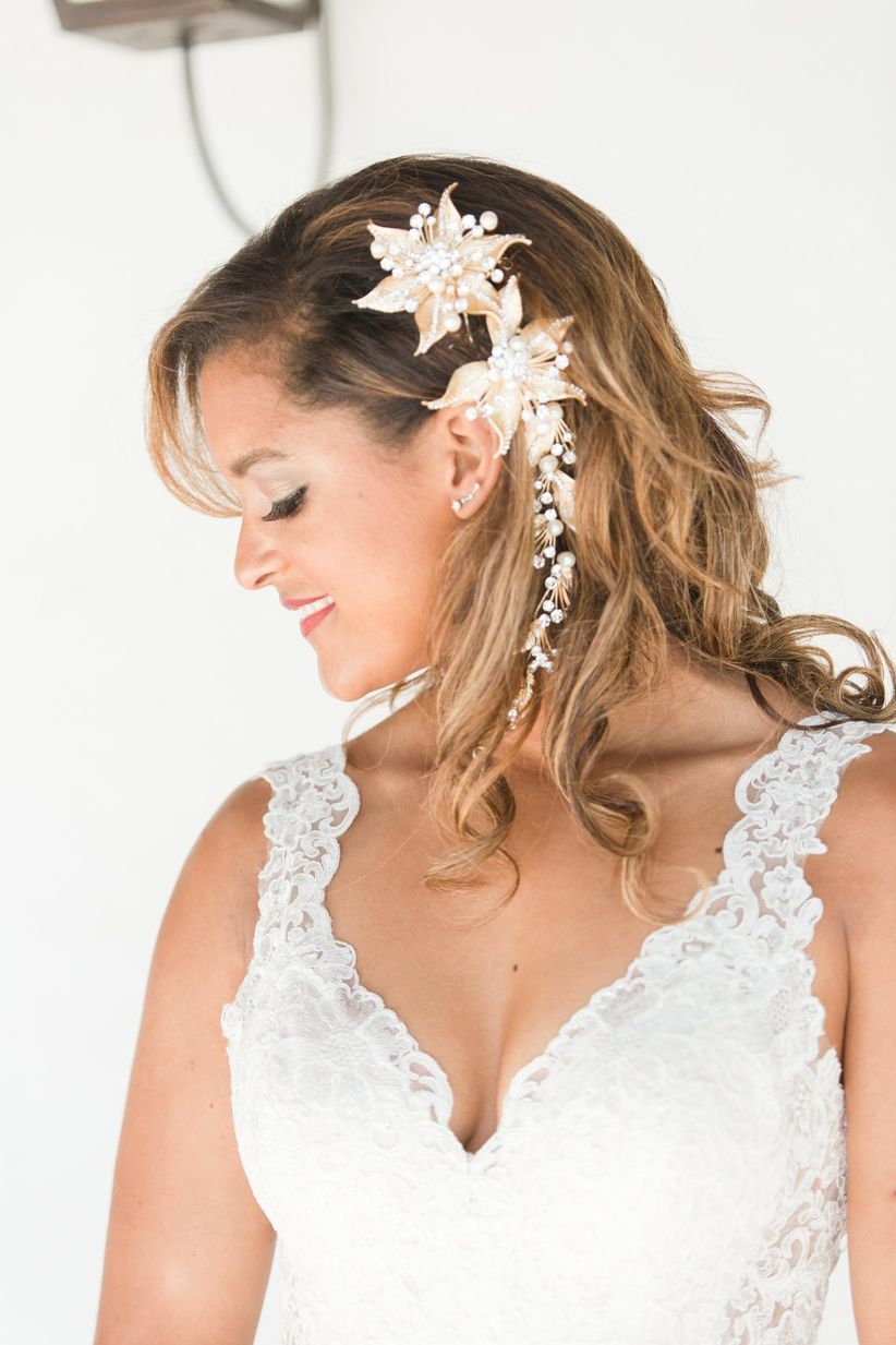 bride with medium length hair and loose curls with pearl hair comb for wedding day