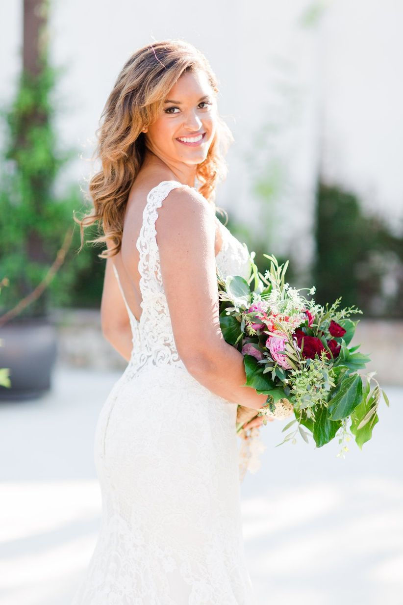 elegant bride with lace low back wedding dress and colorful bouquet