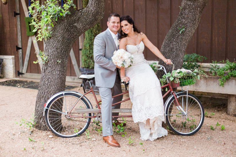 Bride and groom on a tandem bike