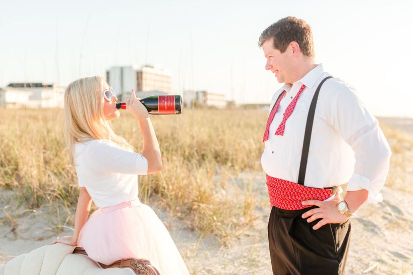 beach engagement with wine