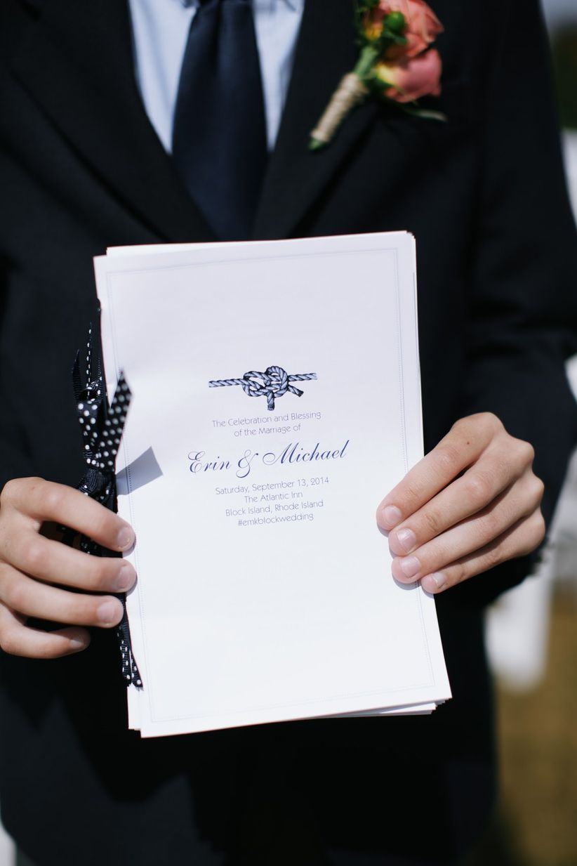nautical wedding ceremony program with navy blue rope knot motif