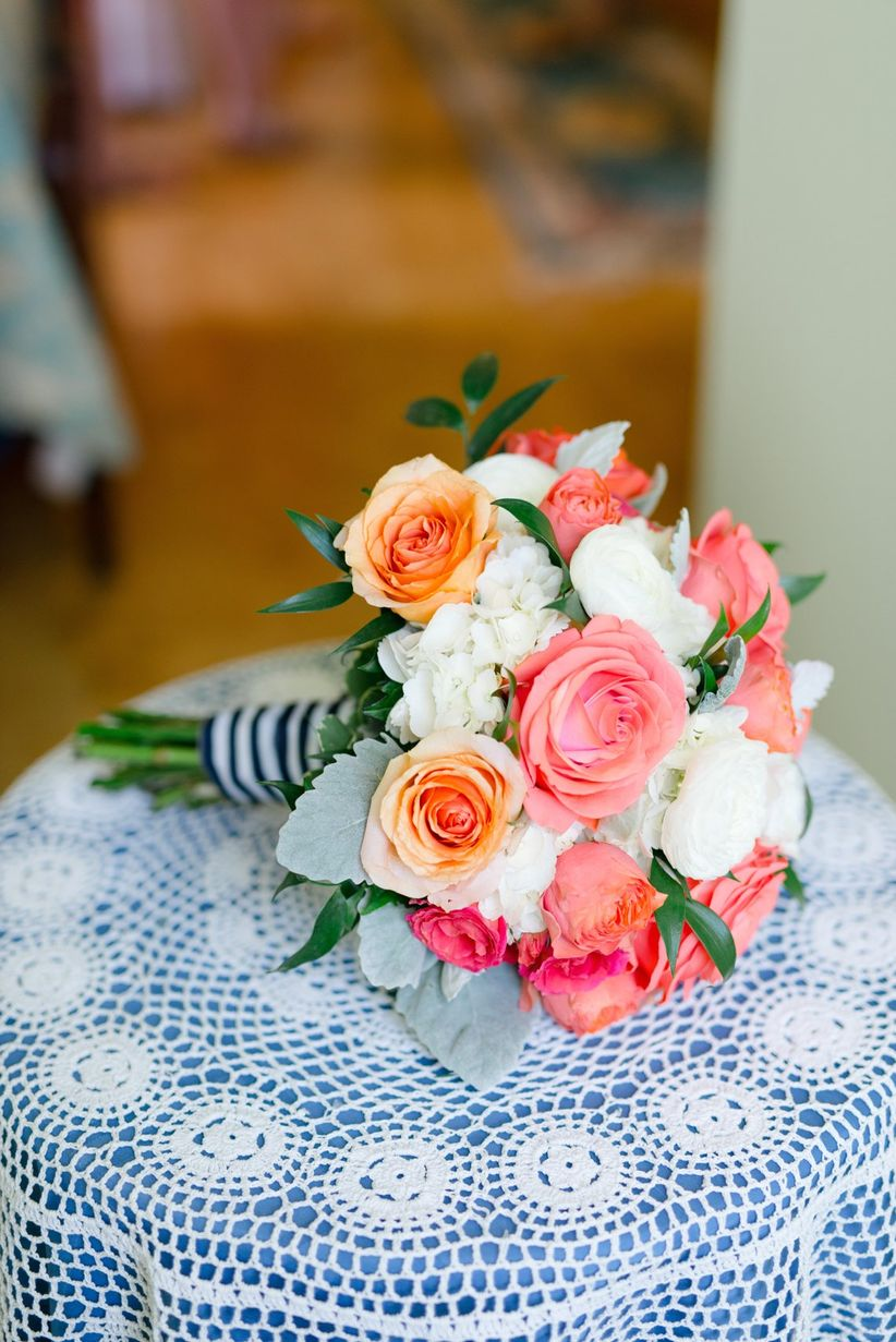 nautical preppy wedding bouquet with coral and orange roses