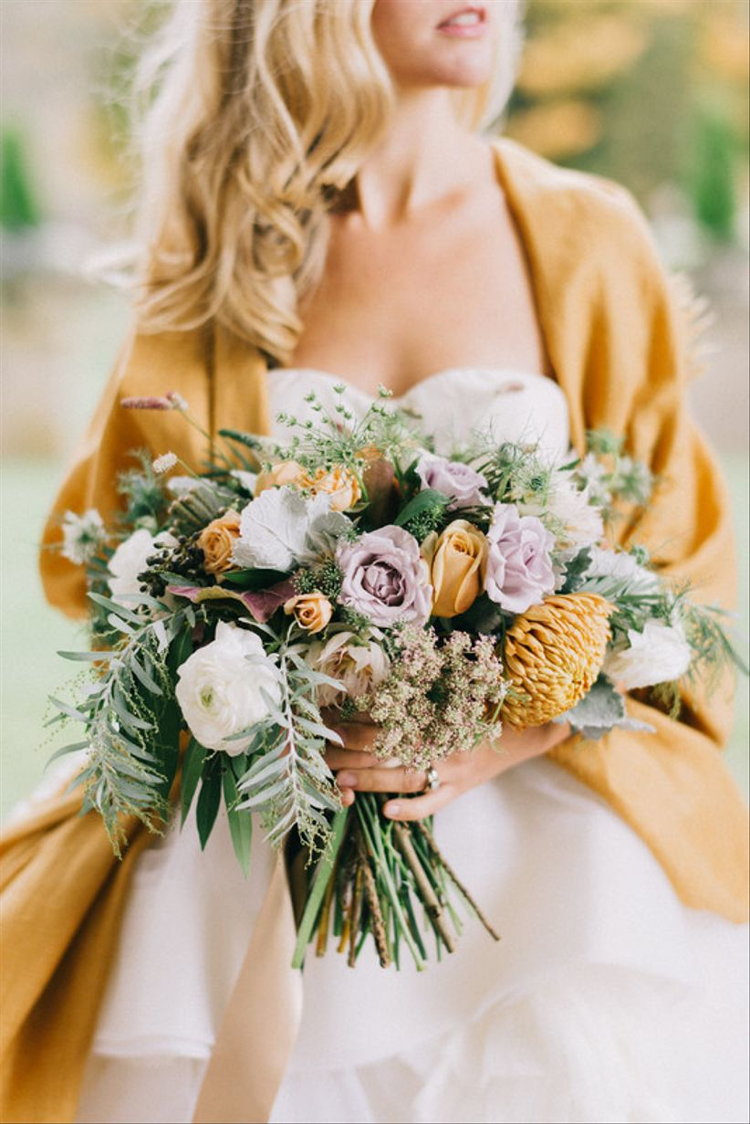 The 2018 wedding flower trends you wont want to miss weddingwire whimsical bouquet with pale yellow and purple flowers greenery mightylinksfo