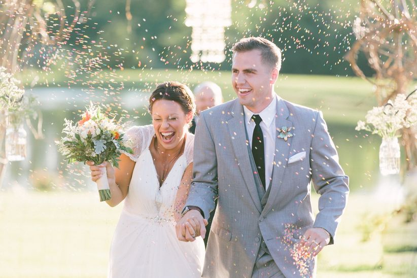 bride and groom recessional with confetti