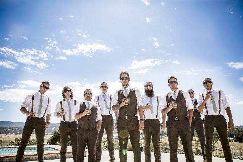 groom and groomsmen holding drinks ballad's photography