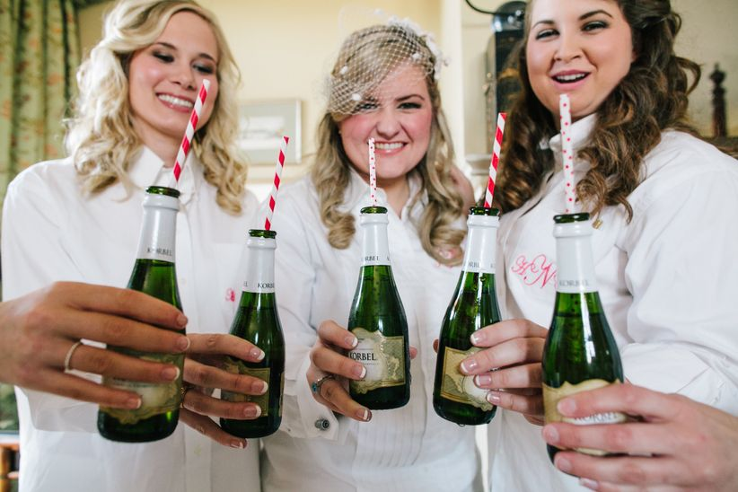bridesmaids holding mini champagne bottles, bachelorette party