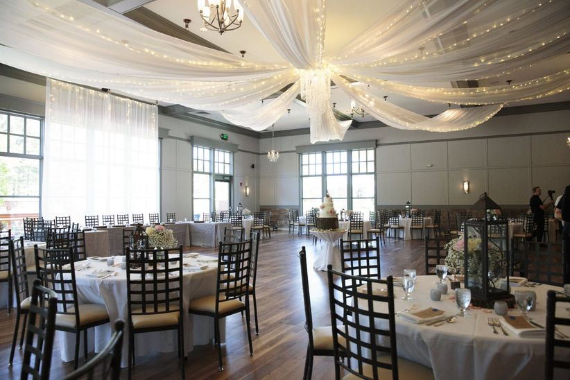 reception room with ceiling draping and twinkle lights