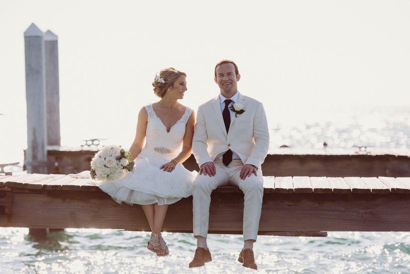 couple on dock destination wedding