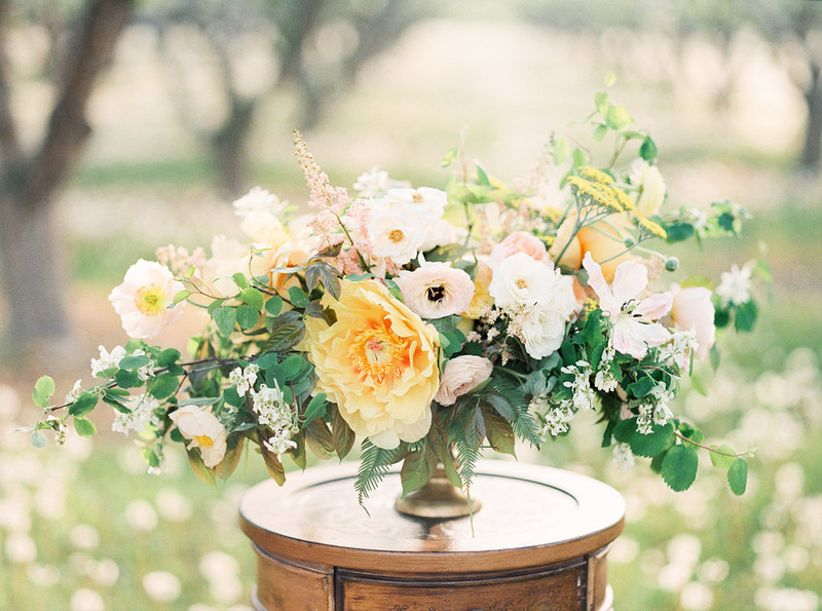 romantic loose centerpiece with giant yellow peony + white flowers + greenery