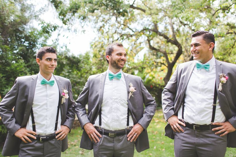 groomsmen in suspenders and bow ties
