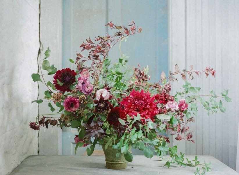 foraged garden wedding centerpiece with ivy, dahlias and ranunculus