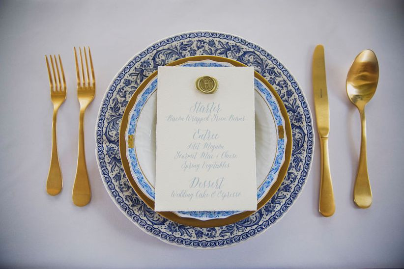 formal blue white and gold place setting hand written menu