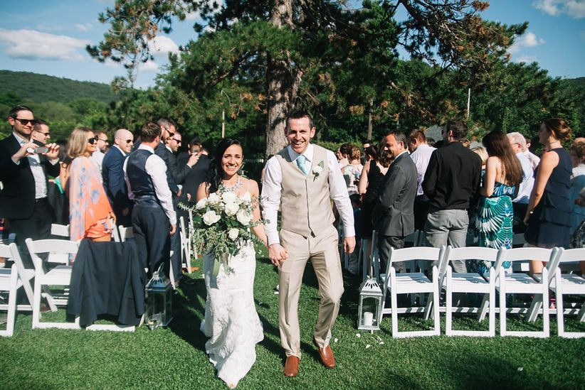 casual outdoor ceremony couple holding hands recessional