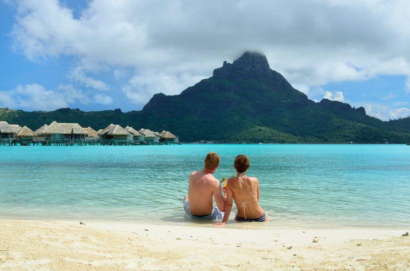 couple overlooking water in bora bora