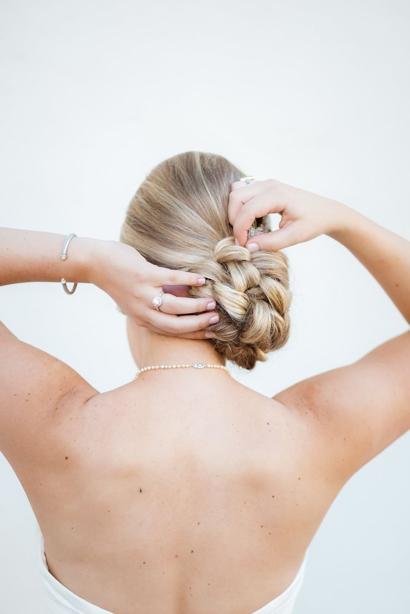 bride with braided chignon hairstyle