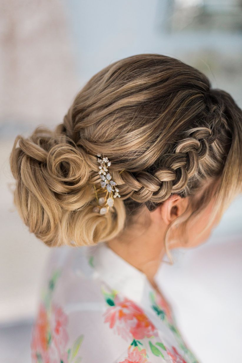 Curly chignon with crown braid and clip