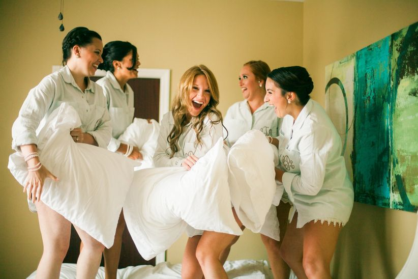 bride and bridesmaids getting ready pillow fight