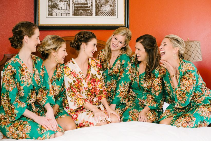 bridal party matching floral robes getting ready