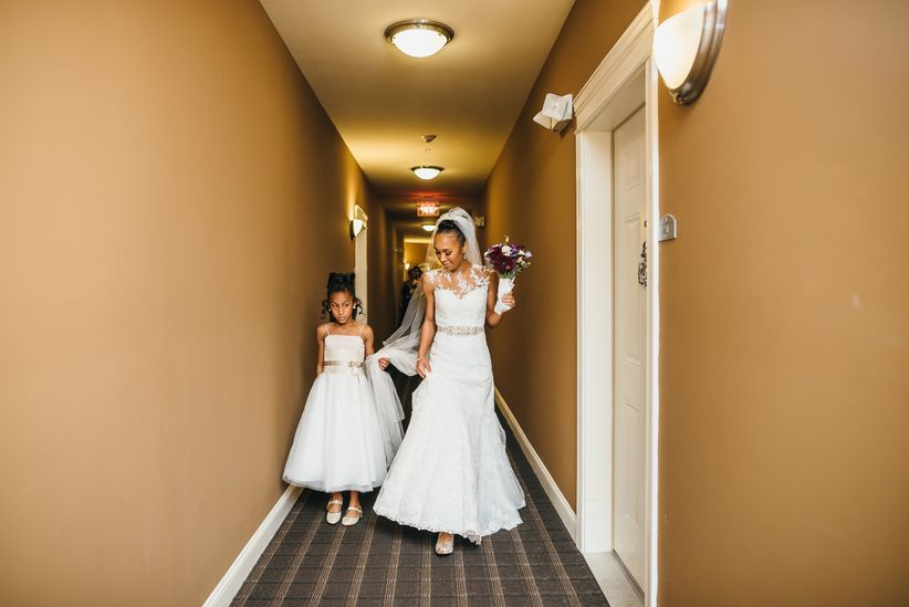 bride walking to ceremony from hotel