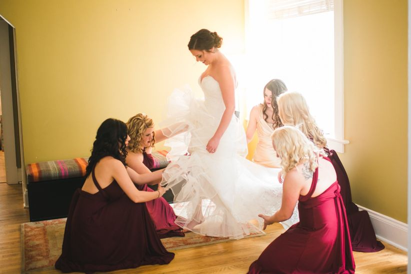 bride and bridesmaids getting dressed