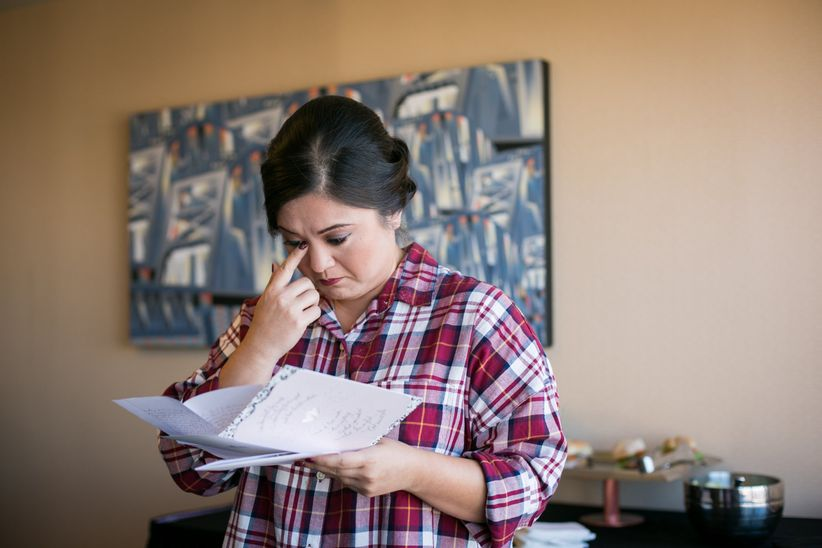 bride crying with love note