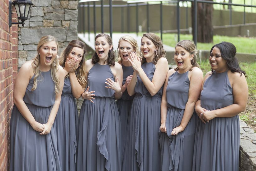 bridesmaids gasping at bride