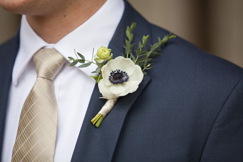 blue suit with anemone boutonniere