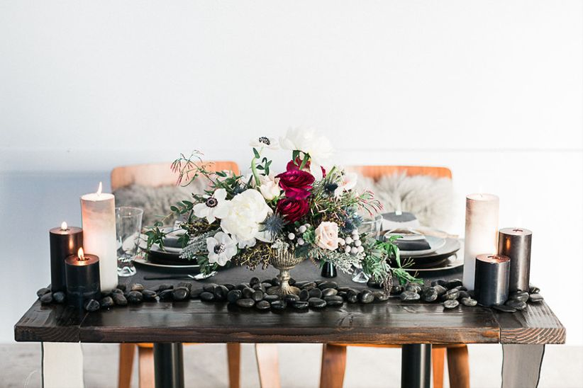moody wedding tablescape, black and burgundy centerpiece with flowers and candles