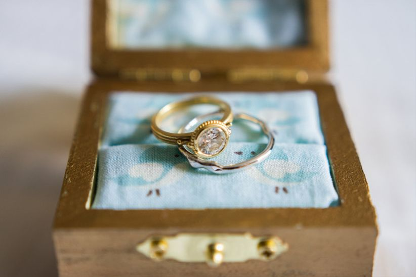 classic round diamond engagement ring with a bezel setting and gold band